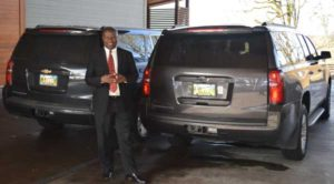 Ron Wamala with 2 Chevrolet Suburbans