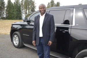 Ron Wamala with a tour vehicle.