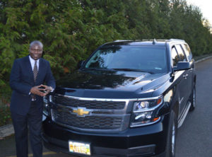 Ron Wamala with luxury SUV