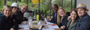 wine tour group with ron wamala at table